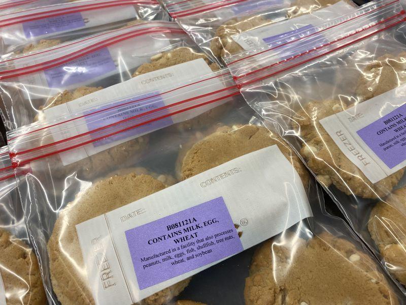 Plastic zipper bags of cookies with allergen and ingredient labels