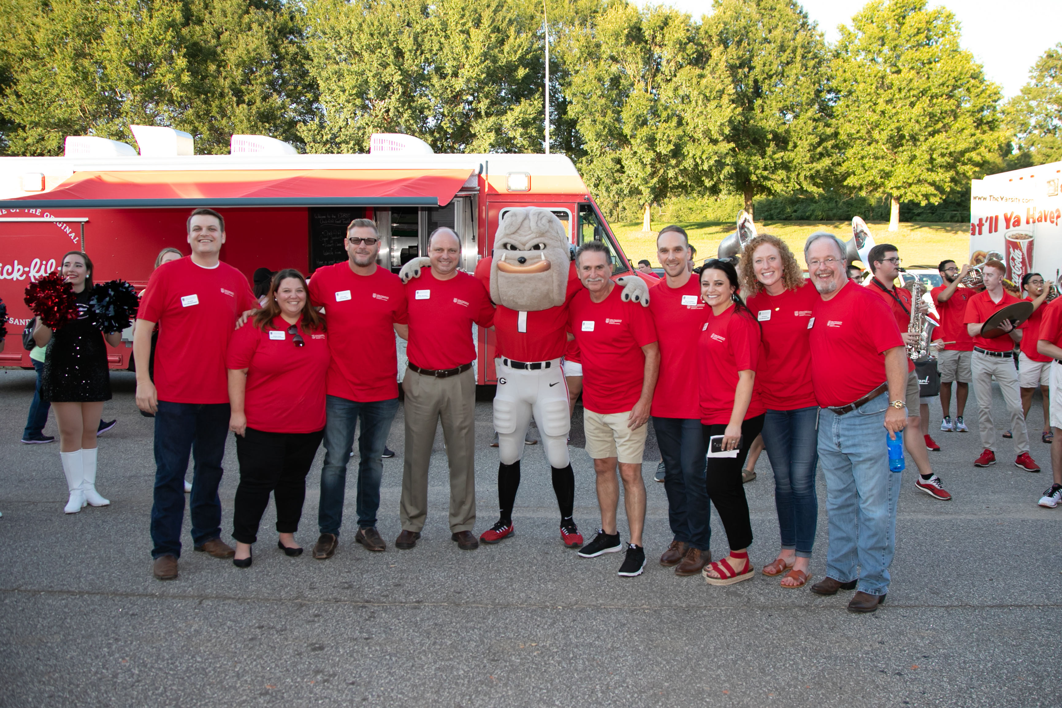 The CAES Alumni Association poses with UGA mascot Hairy Dawg.