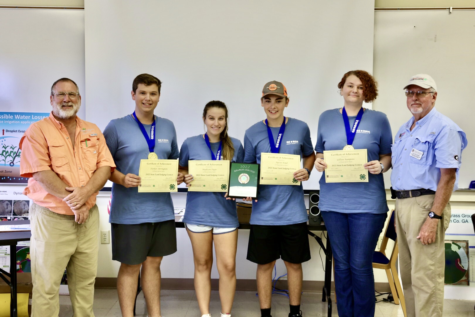 UGA Soil Scientist and judge Glen Harris congratulates the Coweta County Senior 4-H land-judging championship team, including (left to right) Parker Arrington, Madison Dyar, Aaron Boyd and Gillian Ramponi, with Stripling Research Park Superintendent Calvin Perry.