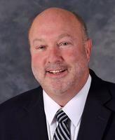 Steve Morse smiles in his professional headshot