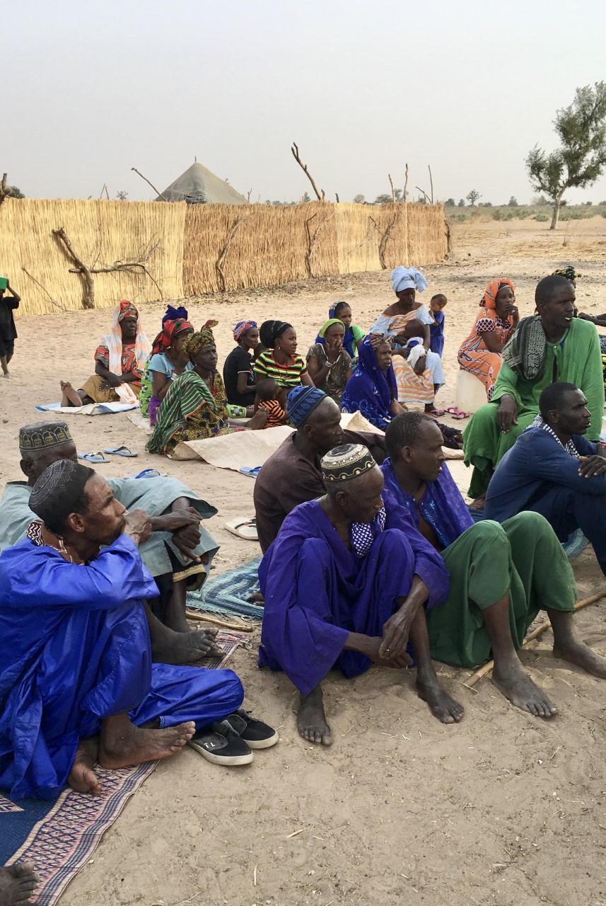 A group of farmers in Senegal receive survey instructions