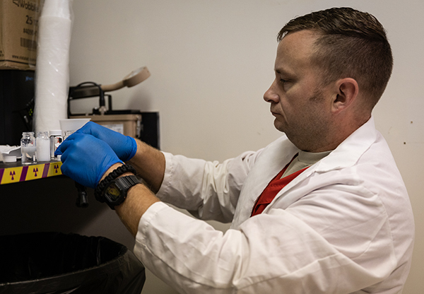 AESL lab manager and analyst David Parks works with water samples to be analyzed for radon contamination.