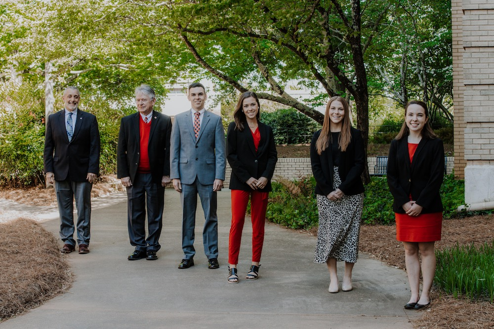 From left, CAES Dean Nick Place and Associate Dean Joe Broder with CAES Congressional Agricultural Fellows Clay Parker, Ivy English, Brooke Raniere and Abby Lauterbach.