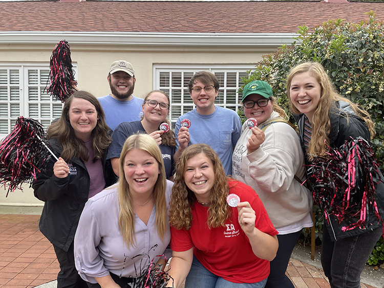 CAES Student Philanthropy Council members (back row, from left) Kaitlyn Hart, Cory Yarbrough, Tyler Hortman, Grant Bennett, Emily Posas, Kelly Tims, (front row, from left) Madison Ristroph and Audri Crewsshow off the CAES buttons students will receive for making a gift during Beat Week.