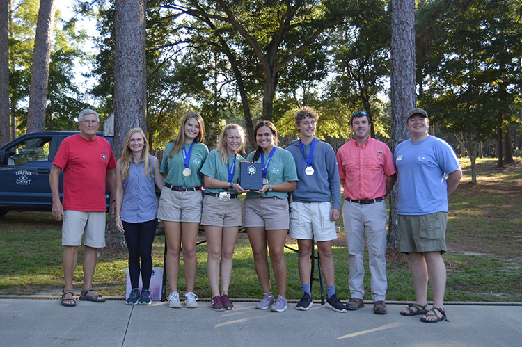 Oconee County's team took first place in this year's state forestry contest. Pictured are (left to right) Henry Walker, owner of Walker Tree Farm; coach April McDaniel, team members Robie Lucas, Lexi Pritchard, Alyssa Haag and Thomas Stewart; Telfair County Agricultural and Natural Resources Extension Agent Colby Royal, and Oconee County 4-H Educator Daniel Queen.