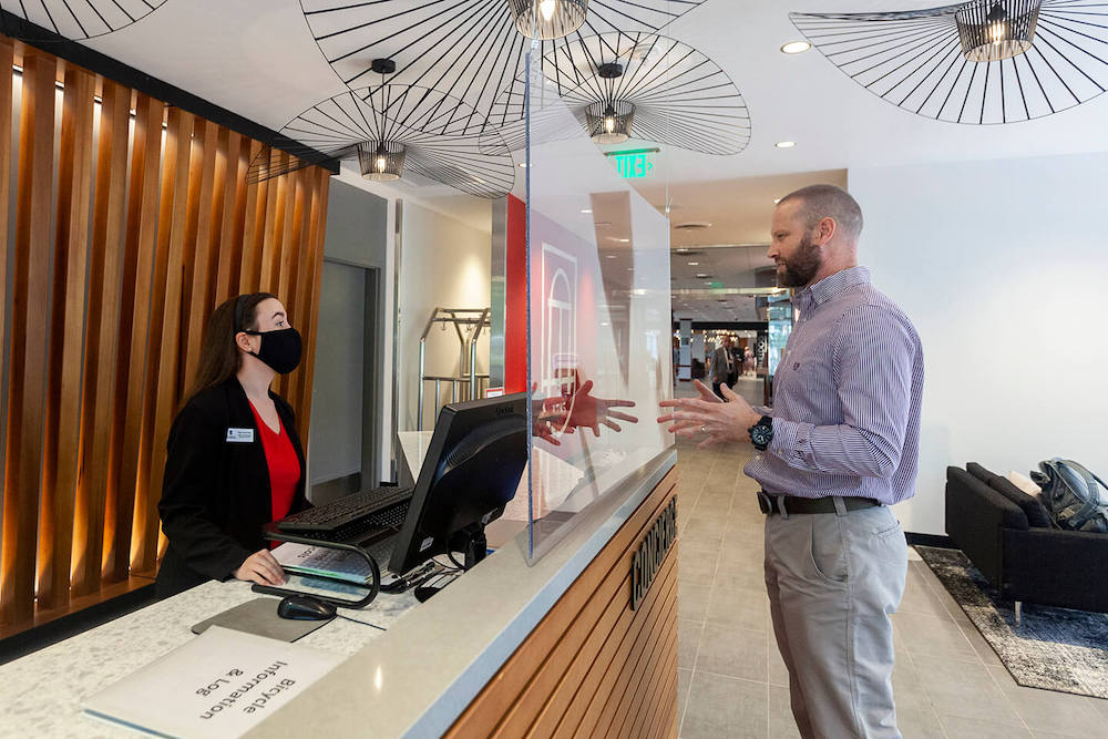 Tyler Grace Hunt (left), a fourth year Hospitality and Food Industry Management major, helps a guest while working at concierge desk of the Georgia Center. (Photo: Shannah Montgomery/PSO)