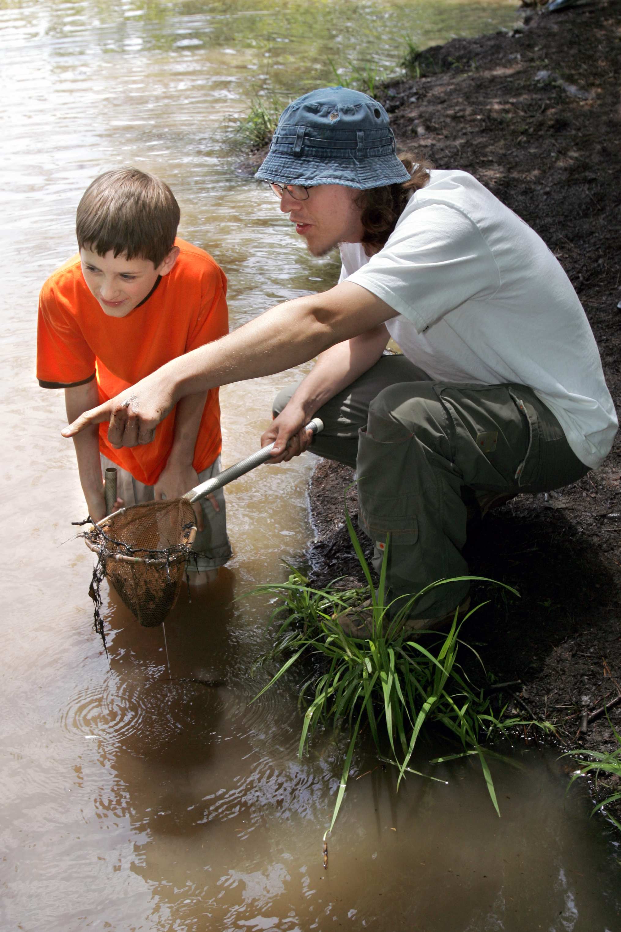 Chris Edmonds of the Rock Eagle 4-H Center takes a sample from the center's lake with the help of a 4-H'er.