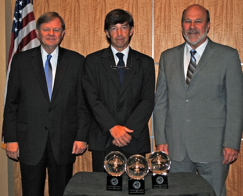 Jim Herring (left), acting chairman of the Christopher Columbus Fellowship Foundation, and AFBF President Bob Stallman (right) present the foundation's Distinguished Agriscience Scientist Award to Dr. Andrew Paterson, distinguished research professor at the University of Georgia.