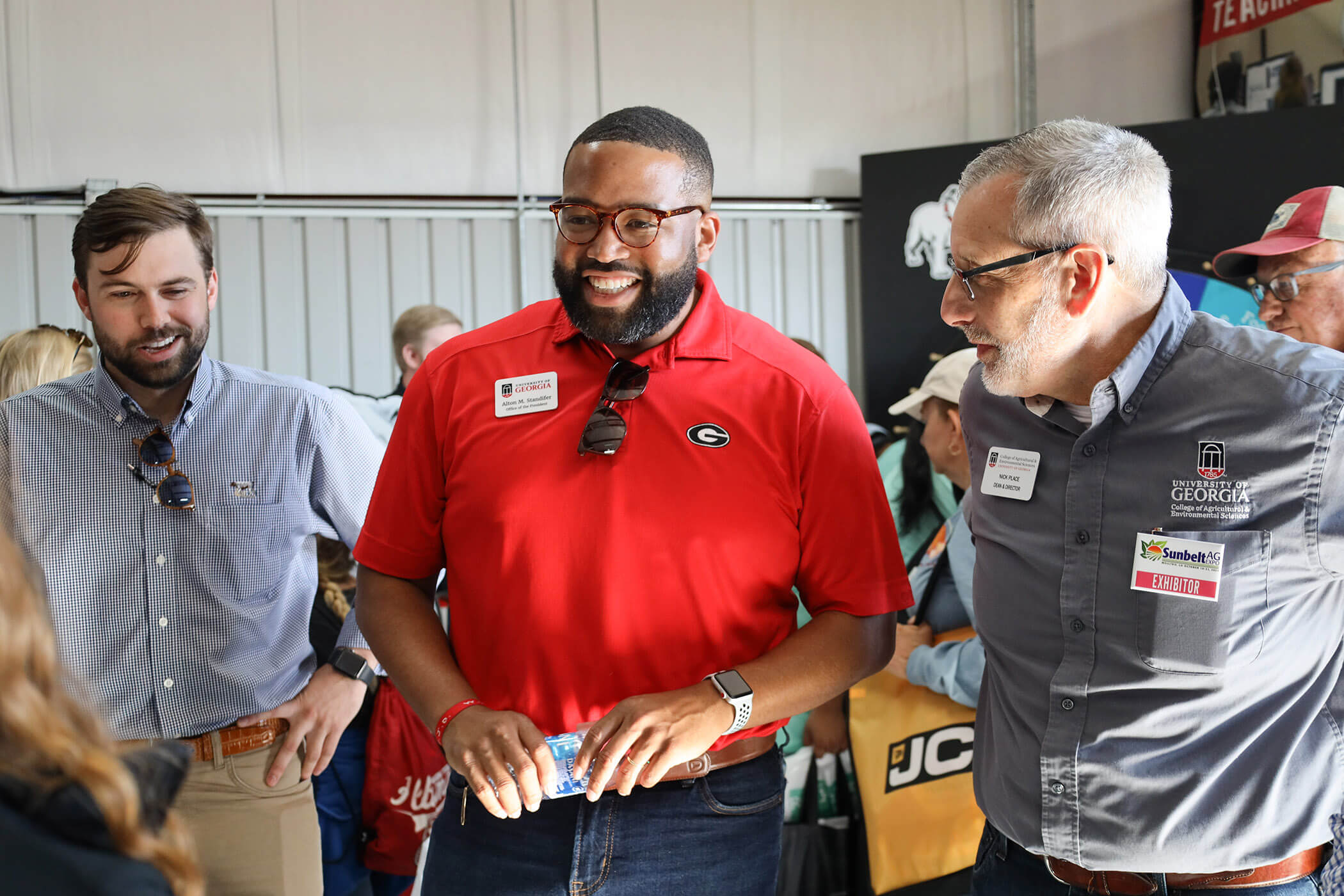 From left, Blake Raulerson, Alton Standifer and Nick Place talk with CAES Ambassadors at the Sunbelt Ag Expo in Moultrie, Georgia. (Photo by Claire Sanders)