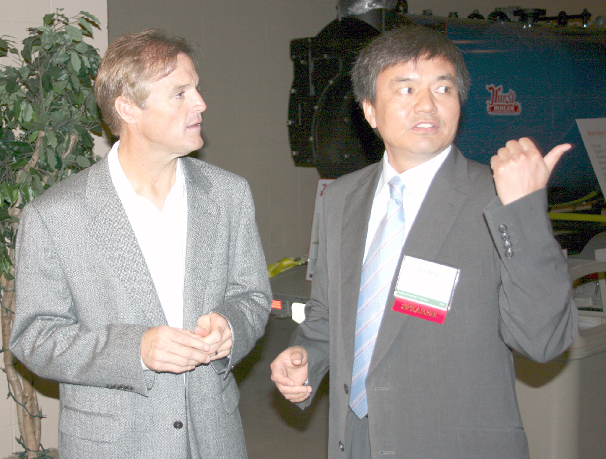 NASCAR Nationwide Series driver Kenny Wallace talks ethanol and alternative energy with Shi-Zong Li, deputy director of China's Tsinghua University Institute of New Energy Technology, at the 6th annual Southeast Bioenergy Conference Aug. 9 in Tifton, Ga.