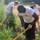 UGA MBA students chop down privet and other weedy shrubs at the Garnett Ridge Community Garden in Athens, Ga., on Aug. 9, 2011. MBA students start their first year off with a community service project.