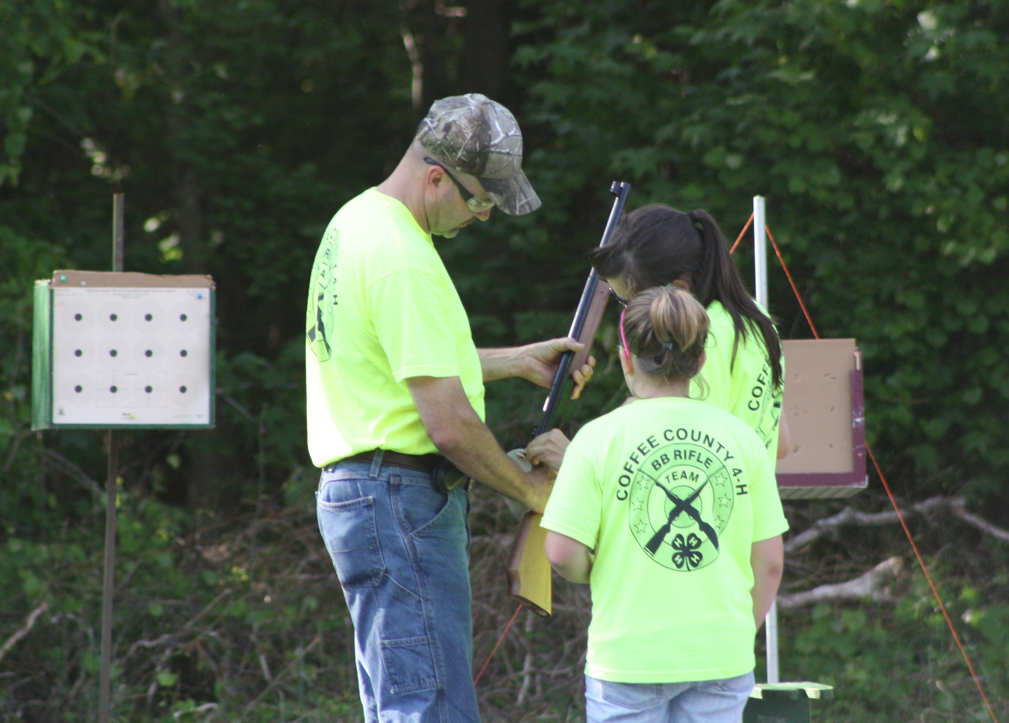 Brian Whitley, a certified rifle coach, is just one of the hundreds of volunteers that donate their time each year to the Georgia 4-H program. Whitley is shown competing in a coaches shoot with assistance from his daughter Danielle Whitley and Hannah Leggett.