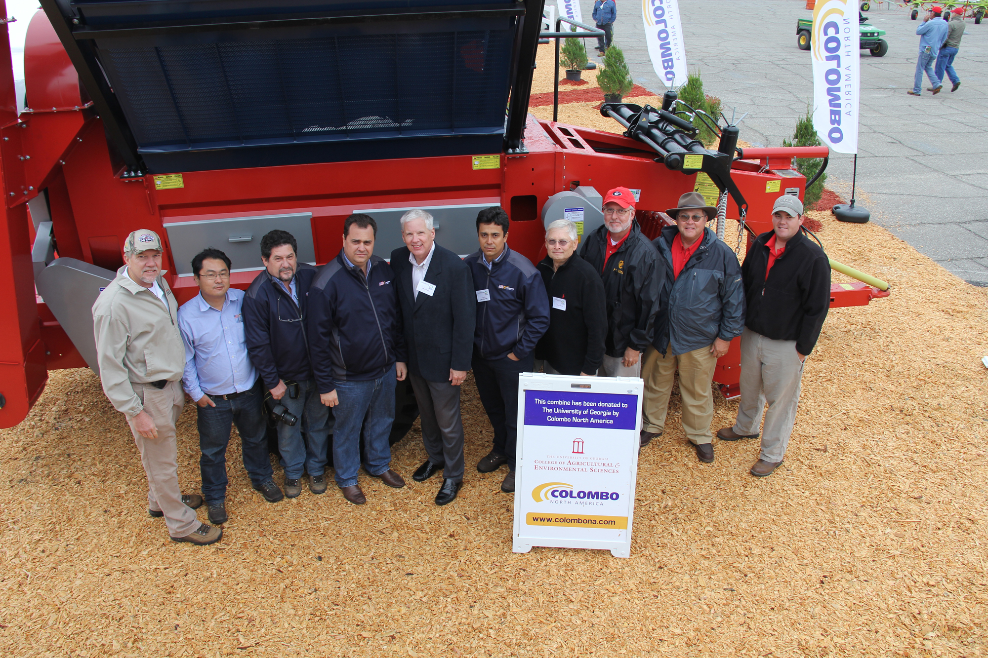 UGA CAES dean and director Scott Angle, center left, accepted a $65,000 two-row peanut combine from Colombo, a Brazilian farm equipment manufacturer, at the 2011 Sunbelt Ag Expo in Moultrie, Ga., Oct. 19. The donated picker will be used for research on the UGA C.M. Stripling Irrigation Research Park in Camilla, Ga.
