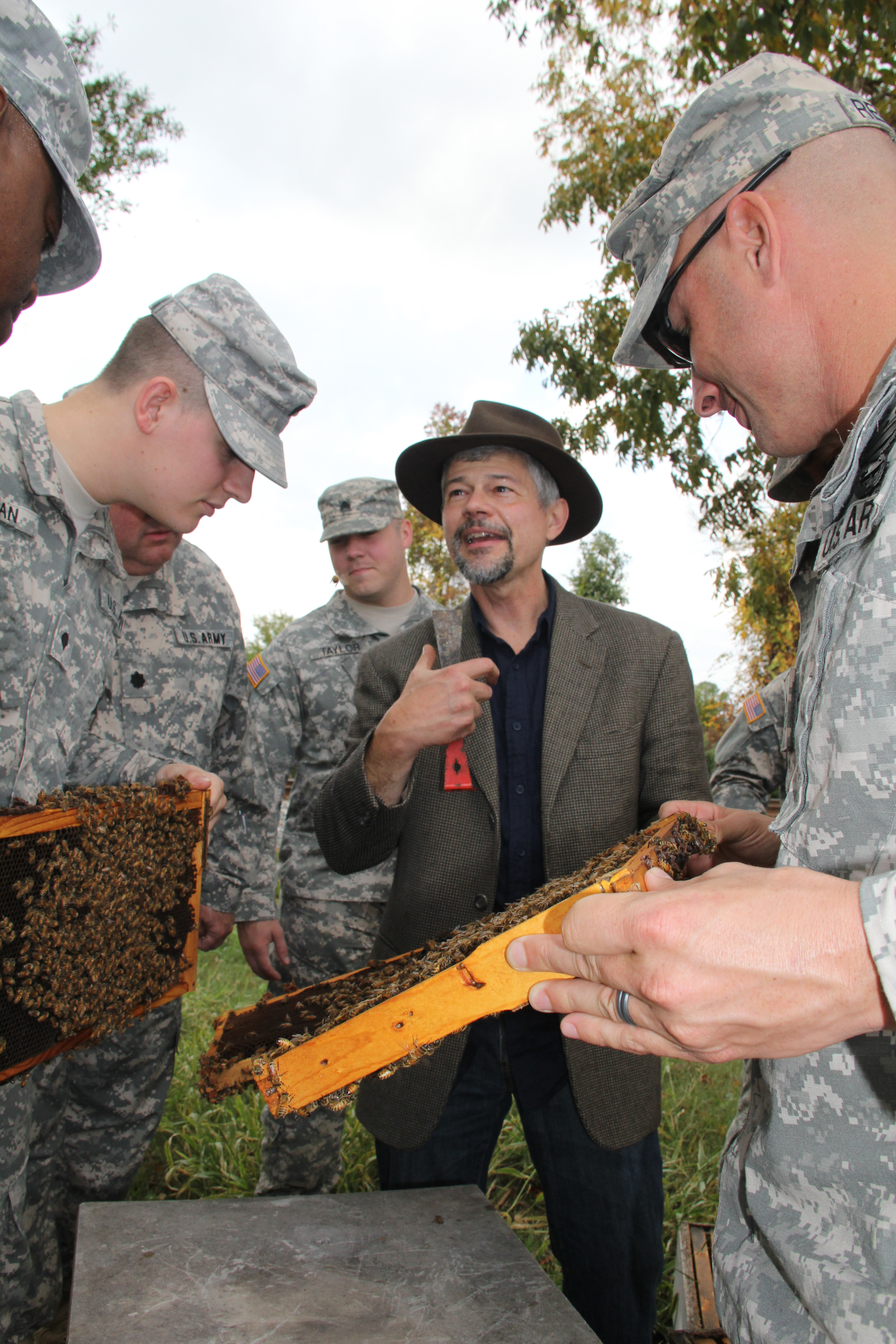 Keith Delaplane works with members of the Georgia National Guard to teach them how to care for beehives. Beekeeping is one program area the female members of the unit will be working in.