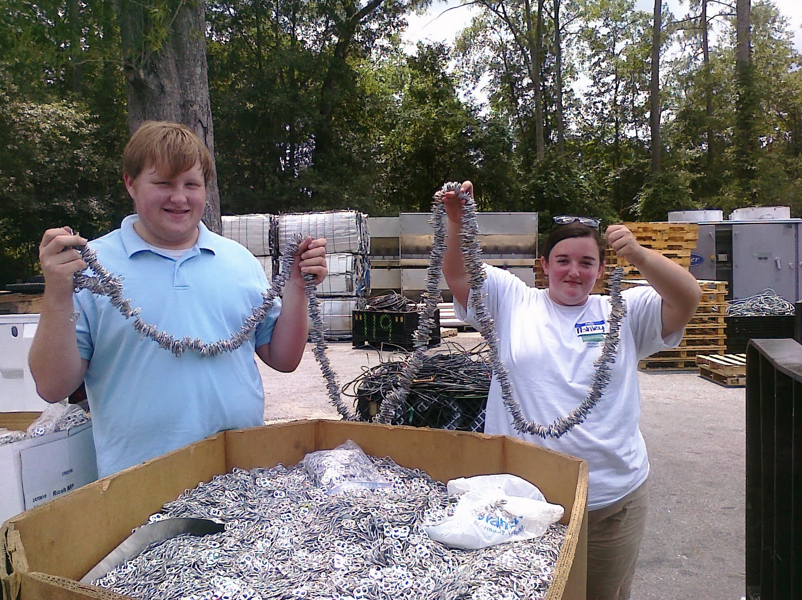 Over the past 10 years, Georgia 4-H'ers have collected aluminum pop tabs to help fund Ronald McDonald House Charities. Joe Wiggins and Ashley Carroll, Colquitt County senior 4-H'ers, are shown displaying the tabs collected in their county.