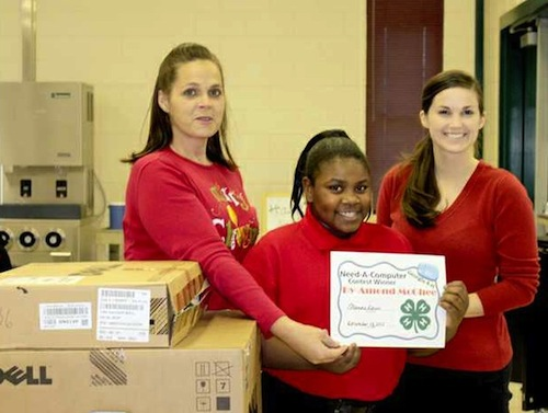 Bryan County Elementary School fifth-grader Dy'Amond McGhee (center) is all smiles with Bryan County 4-H agent Shanna Davis (left) and her teacher Katelyn Finnegan. McGhee was one of 34 4-H'ers across Georgia who won a new Dell computer through a 4-H contest.