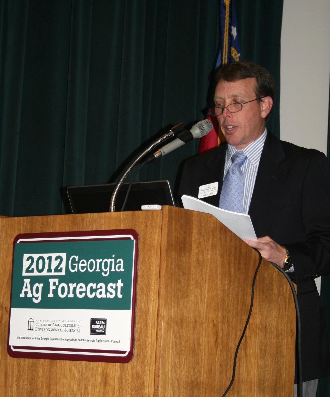 University of Georgia Extension economist Nathan Smith delivers the 2012 ag forecast to a group in Macon, Ga., at the Georgia Farm Bureau.