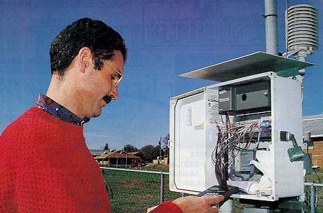 Gerrit Hoogenboom is shown calibrating the weather station at the University of Georgia campus in Griffin, Ga.