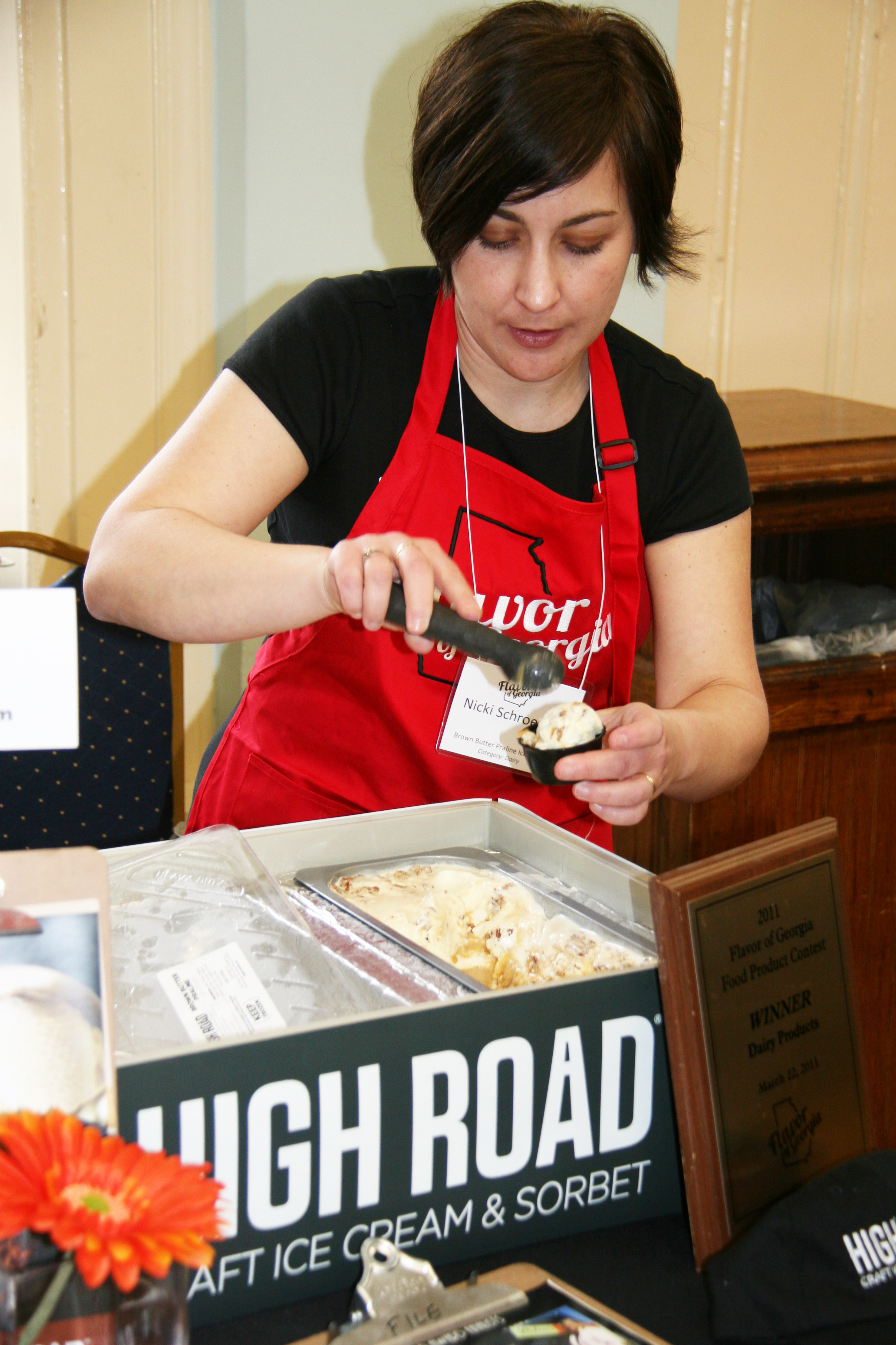 Nicki Schroeder, of High Road Craft Ice Cream in Atlanta, scoops a serving of ice cream for the judges at the 2012 Flavor of Georgia Food Product Contest.