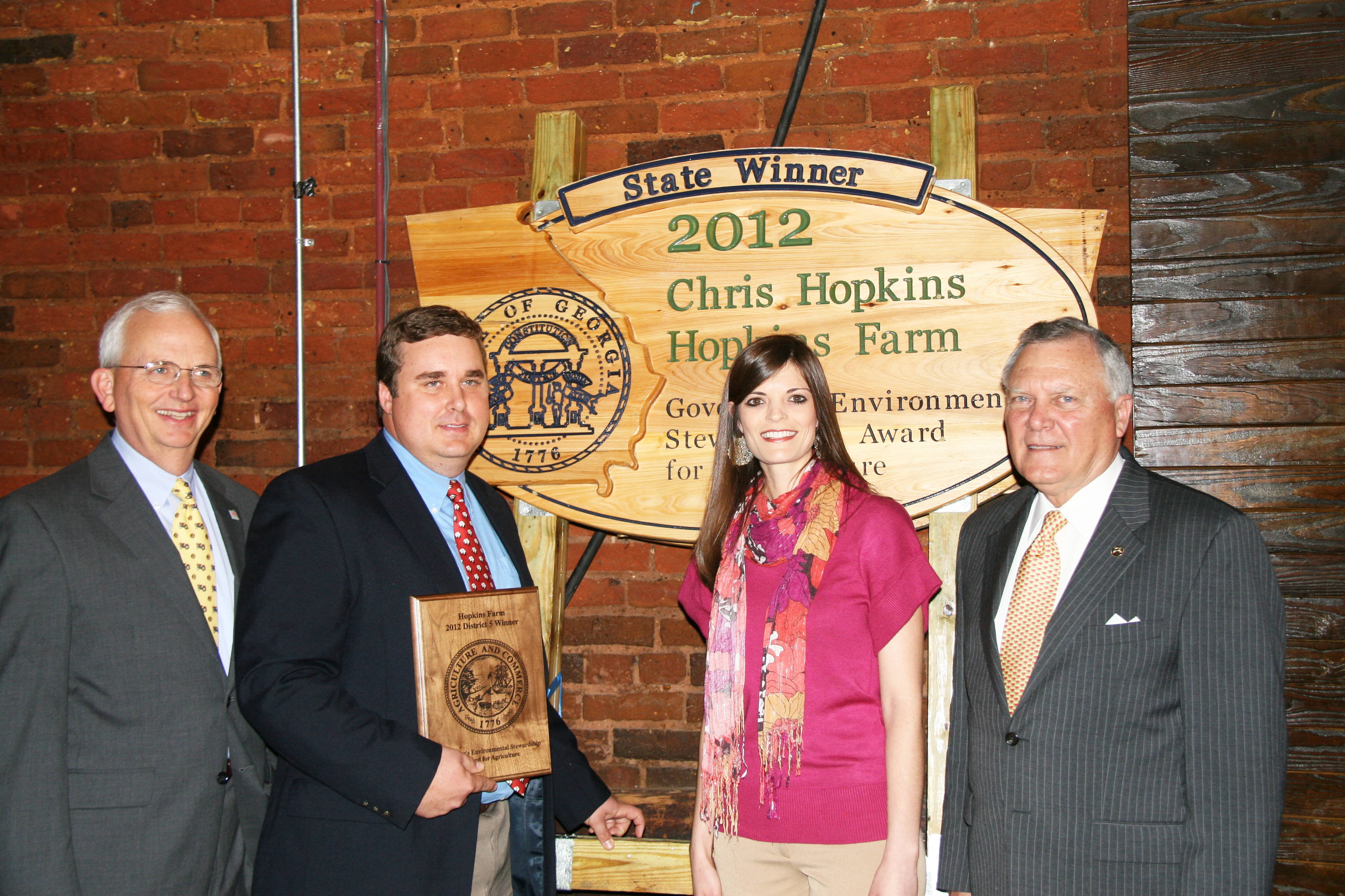 Governor Nathan Deal and Commissioner of Agriculture Gary Black present the 2012 Governor's Environmental Stewardship Award to Chris and Marilynn Hopkins of Lyons, Ga.   Stewardship Award Winner Chris Hopkins at Agricultural Awareness Day at the Georgia Fre