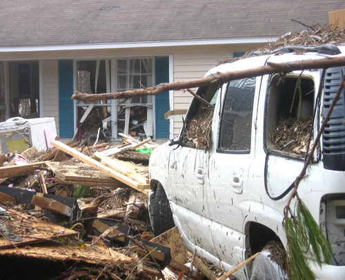 Debris is shown strewn inside a vehicle and home as a result of a hurricane in Mississippi.