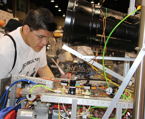 4-H'er Manolo Hernandez makes adjustments to the Lumpking County High School robotics club's robot