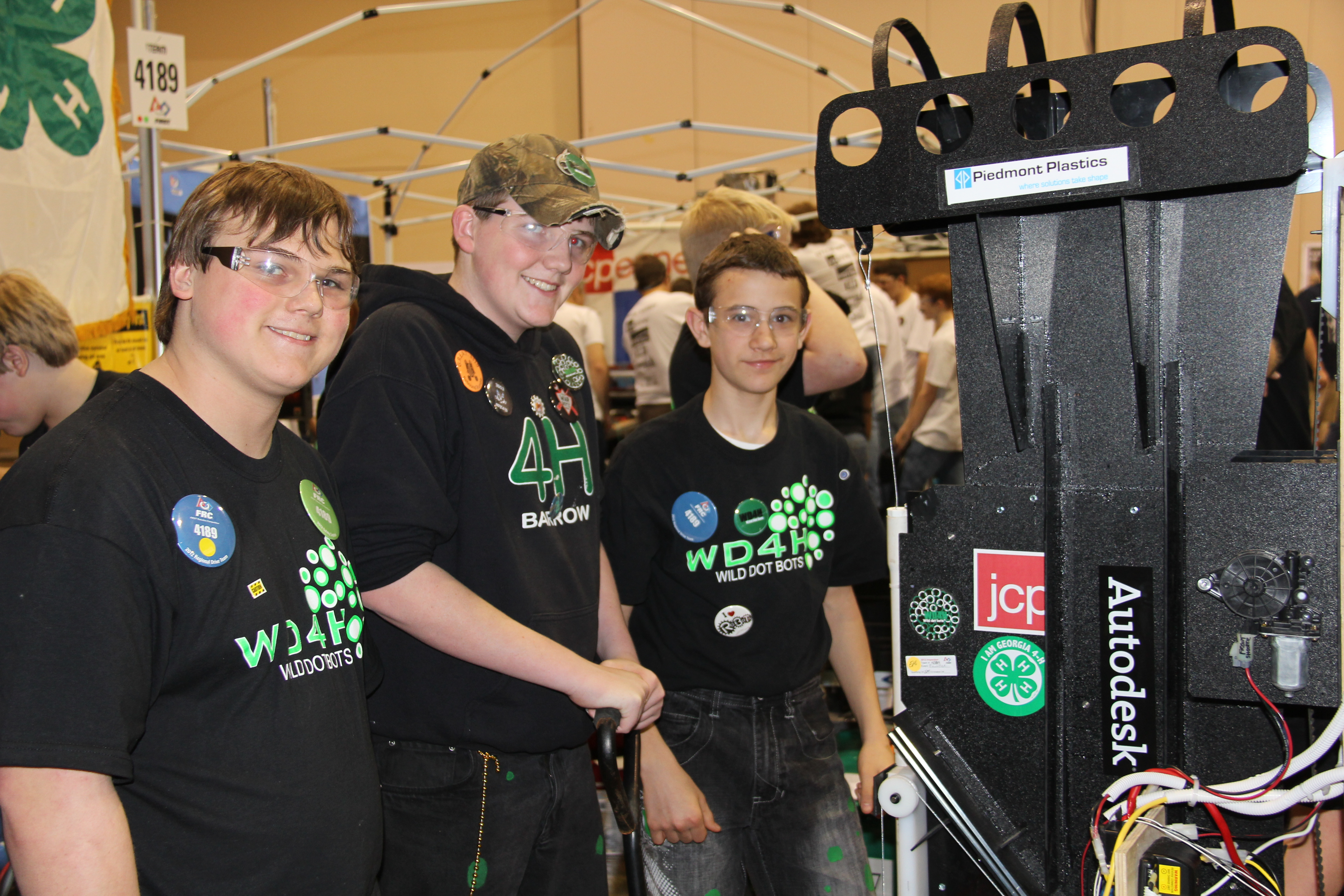 Barrow/Jackson County 4-H'ers (l-r) Jeffery Littleton, C.J. McLocklin and Travis Adams prepare to take their robot into competition.