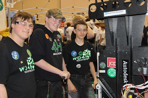 Barrow/Jackson County 4-H'ers (l-r) Jeffery Littleton, C.J. McLocklin and Travis Adams prepare to take their robot into competition.