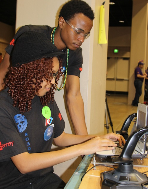 4-H'ers Dorothy Gilcrest and Brandon Chambers program the robot representing Westlake High School in Atlanta, Ga.