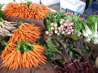Fresh vegetables at a vendor stand at the Athens Farmers Market in Athens, Ga.