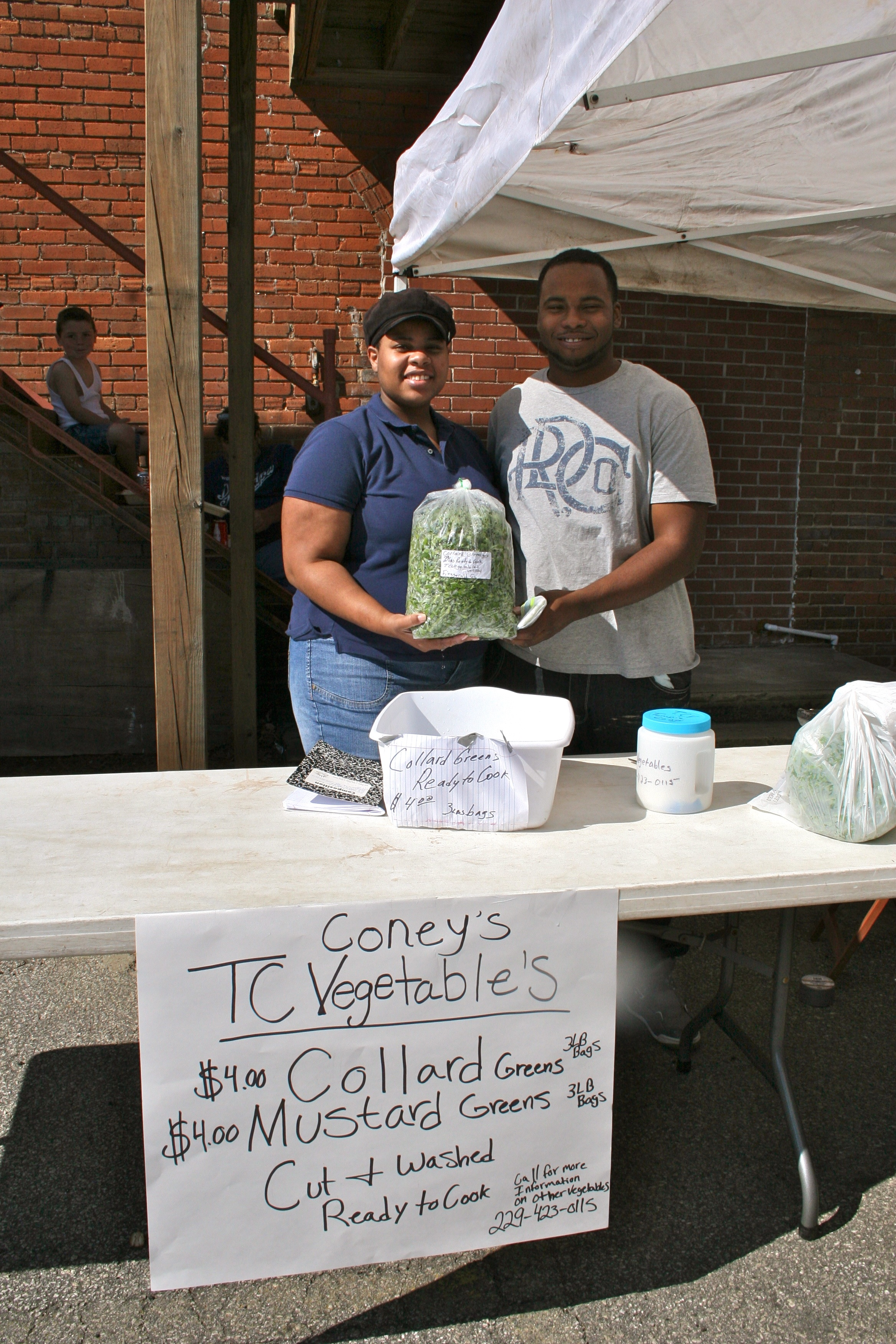 Tempest Coney and Randall Richardson of TC Coney Vegetables at the downtown farmers market in Tifton, Ga.