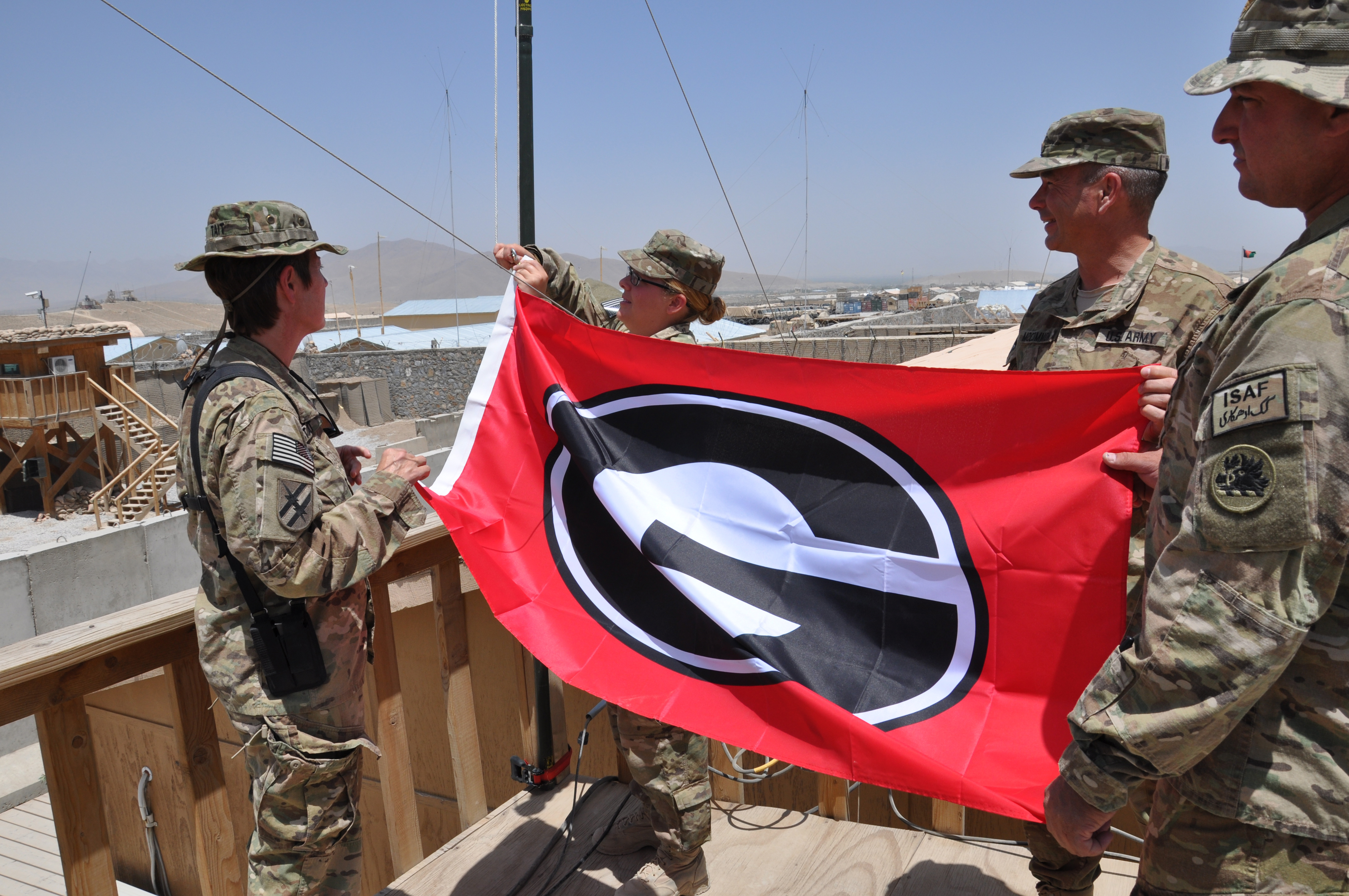 Georgia National Guardsmen with the 201st Regional Support Group's Agribusiness Development Team hoist a University of Georgia flag over their base in Logar Province, Afghanistan. The Augusta-based unit served in Afghanistan from May 2011 to May 2012. They will present a base flag, now autographed and war torn, to the administration of the UGA College of Agricultural and Environmental Sciences during a ceremony June 11 at Conner Hall on UGA's Athens Campus.