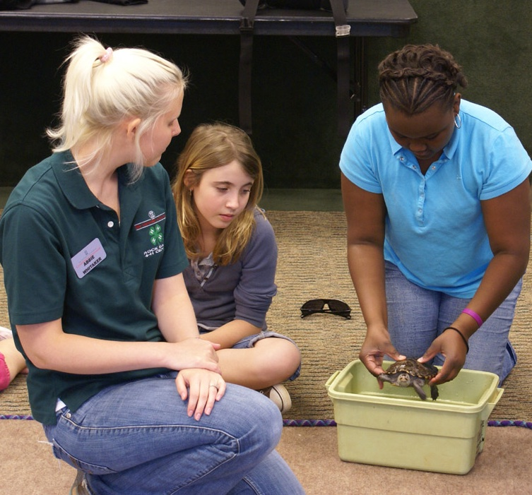 Abbie Whittaker leads a reptile and amphibian class at Rock Eagle 4-H Center in Eatonton, Ga.