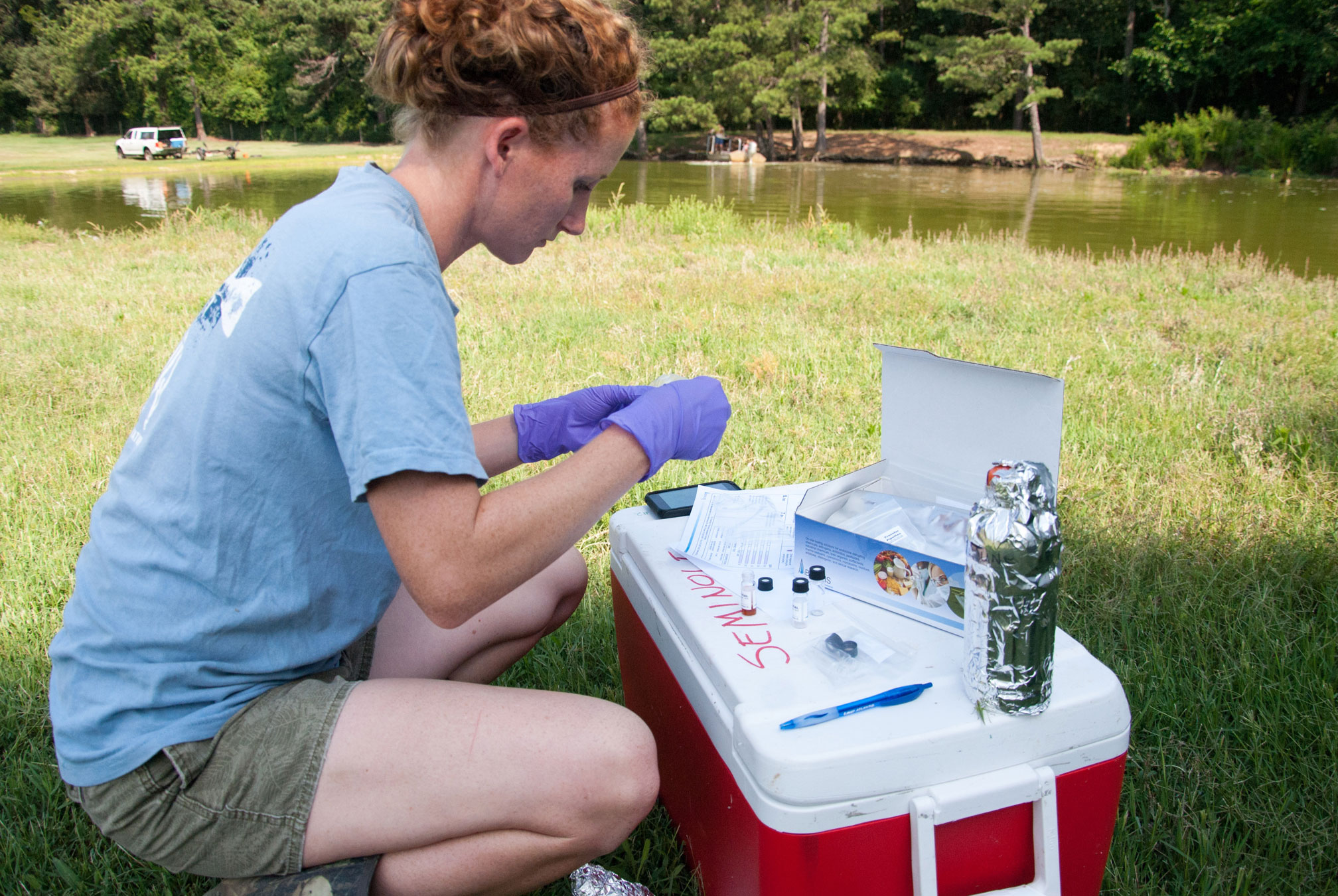 Rebecca Haynie, a toxicologist with the UGA Warnell School of Forestry and Natural Resources, checks water samples at a farm in Dacula.