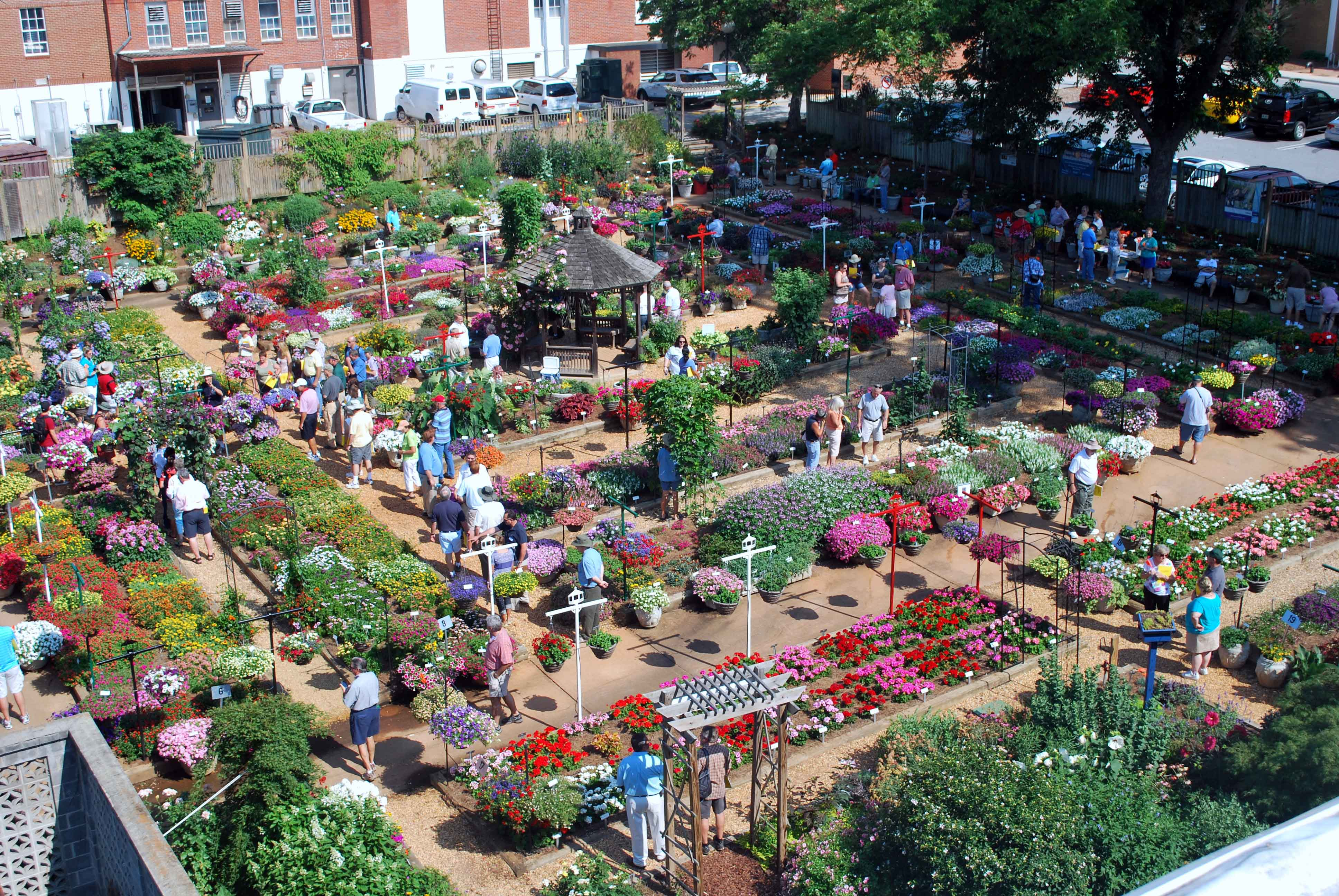 A crowd browses the Trial Gardens at UGA at an industry open house earlier this summer. The gardens are expected to be in full bloom for the public open house on July 9.