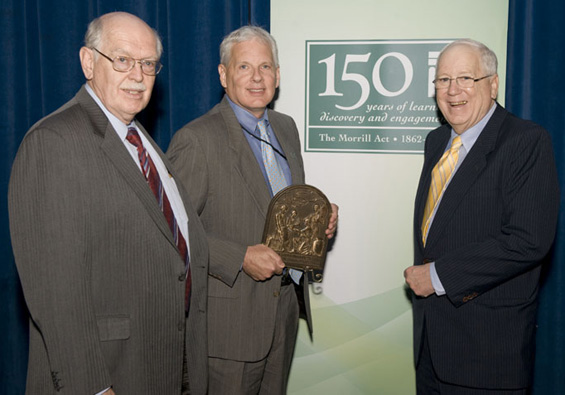 Scott Angle, dean of the UGA College of Agricultural and Environmental Sciences, accepts the World Food Prize Foundation's Borlaug Medallion. (L-R, Peter McPherson, APLU president; Scott Angle; Amb. Kenneth Quinn)